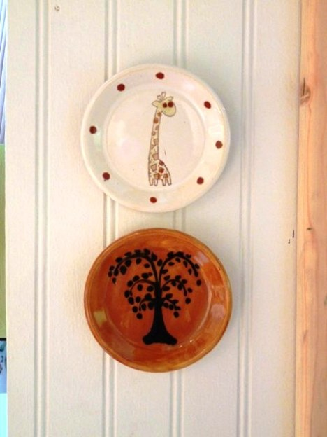 Little plates, a gift from my Mother In Law (also, my friend) hung with velcro!