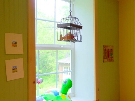 Through the opening in my studio and out the window in the kids' playroom. In case you're wondering, the bird cage contains a fish from Cuba and a frog from Mexico.